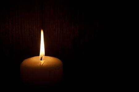 Single lit candle Foto de archivo