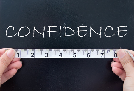 confidence: Measuring confidence Stock Photo