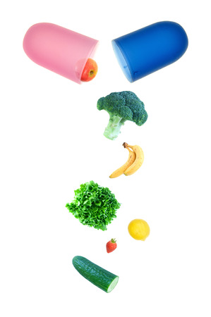 Vitamin pill with fruits and vegetables Standard-Bild