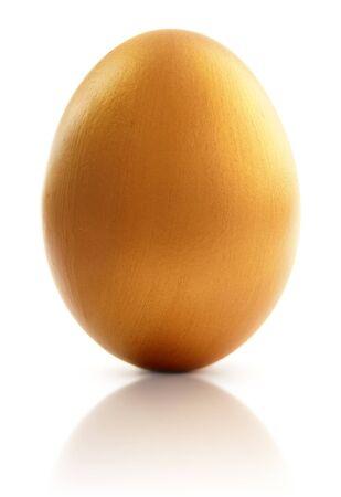 golden egg: Golden egg over a white background