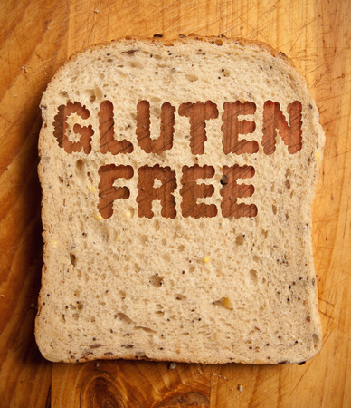 free: Gluten free text etched into a slice of bread