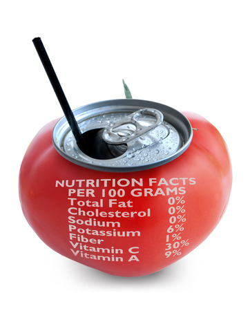 nutrition label: Fresh tomato juice can over a white background with nutritional data