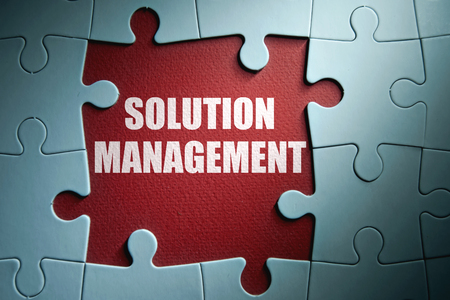 management: Missing pieces from a jigsaw puzzle revealing solution management Stock Photo
