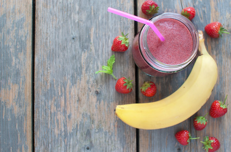 summer food: Strawberry smoothie in a jar with copyspace