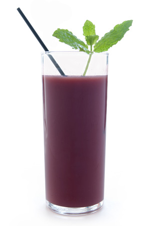 acai: Acai berry smoothie in a glass with mint leaves over a white background Stock Photo