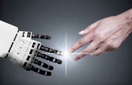 tecnologia: Robô e dedos indicadores tocantes humanos Banco de Imagens