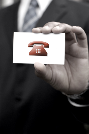 landlines: Business man holding contact card with phone business icon