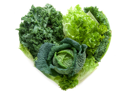 Green healthy vegetables in the shape of a heart isolated over a white background Archivio Fotografico