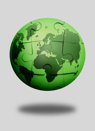 polution: Green jigsaw puzzle globe over a white background