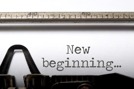 New beginning printed on an old typewriter Standard-Bild