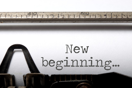 New beginning printed on an old typewriter Stockfoto