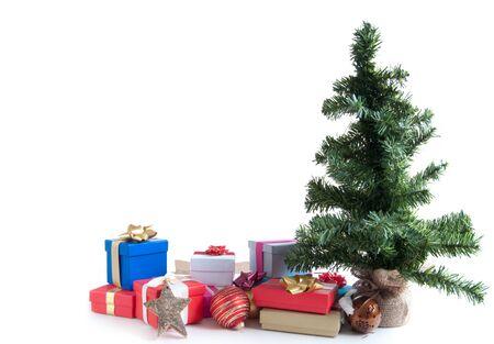 christmas gift box: Christmas presents around a tree