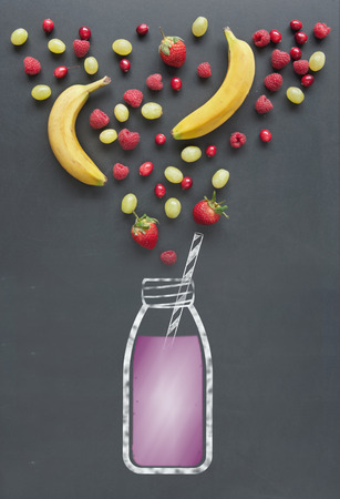food and drink: Fresh fruit including berries, cranberrries and raspberries next to a drawing of a smoothie on a chalkboard
