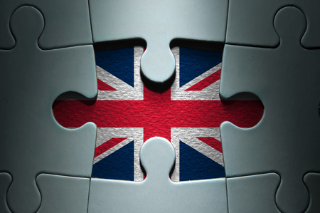 british: Missing piece from a jigsaw puzzle revealing the British flag Stock Photo