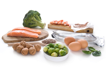 salmons: Collection of foods high in omega over a white background Stock Photo