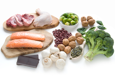 Foods sources for iron including meat, fish, pulses and seeds Stockfoto