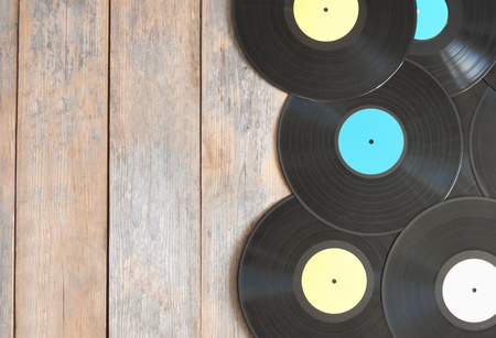 lps: Vinyl records on top of wood with space
