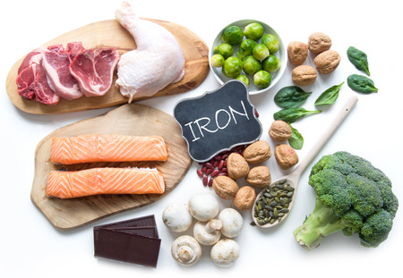 Foods rich in iron including meat, fish, pulses and seeds Stockfoto