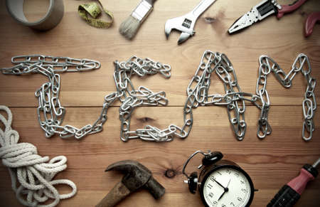 office tool: Team made from a chain surrounded with work tools Stock Photo