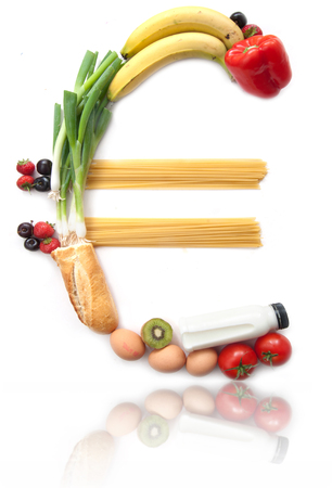 Euro currency sign made from food groceries over a white background