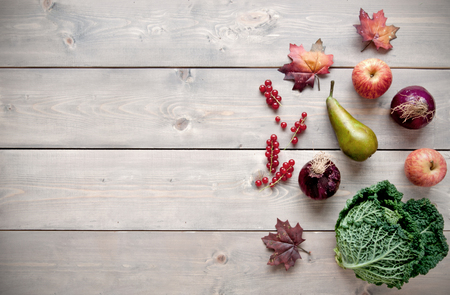 natural selection: Selection of natural autumn produce over a wooden background with space