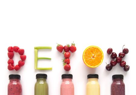 Detox word made with fruits from assorted fruit smoothies over a white background Stock Photo