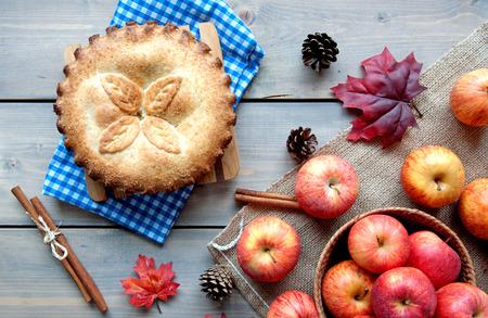cinammon: Apple pie with ingredients, cinammon sticks and autumn leaves
