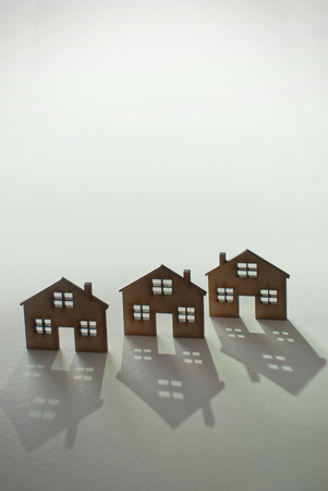 small houses: Three small houses in a row with space for text Stock Photo