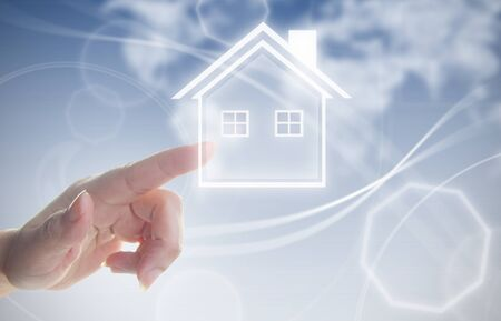 ambitions: Finger pressing touch screen interface with house real estate symbol Stock Photo