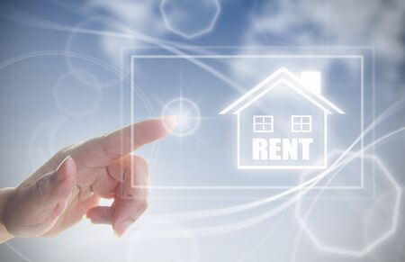 touch screen: Finger pressing touch screen interface with house real estate rental sign