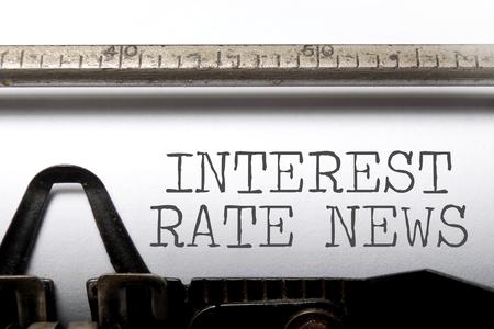 interest rates: Interest rates headline printed on an old typewriter