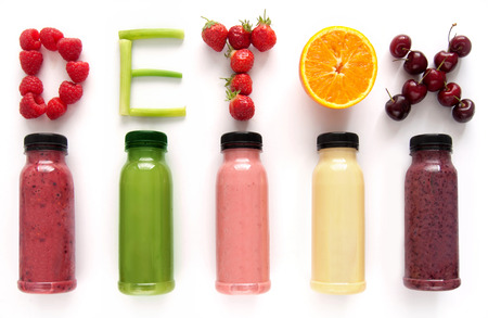 cleanse: Detox word made with fruits from assorted fruit smoothies over a white background Stock Photo