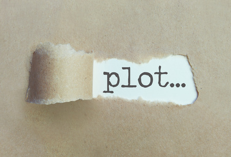 and plot: Torn brown paper revealing the word plot Stock Photo