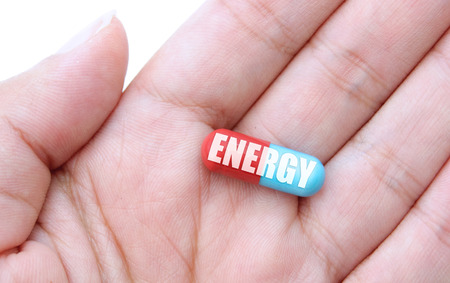 enhancing: Close up of a hand holding an energy pill