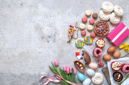 chocolate treats: Assorted easter sweets, bakery cupcakes, chocolate eggs and confectionery with space