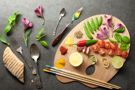 Painters food seasoning palette with colorful herbs spices and fresh ingredients