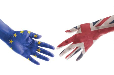 debating: Hands painted with UK and European flags reaching out for a handshake Stock Photo