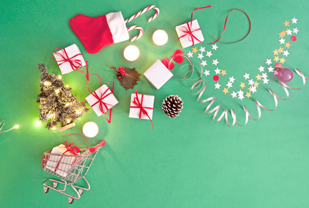 Christmas gifts, baubles, and decorations coming out of a shopping cart Stock Photo