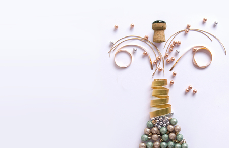 Champagne bottle made from decorations including baubles and ribbon Stock Photo