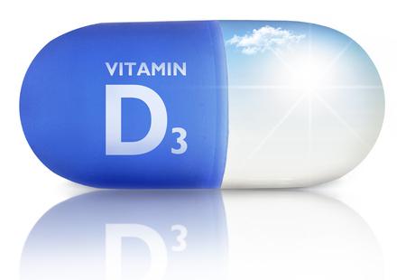 Schließen Sie oben von einer Pille mit Vitamin D Sonnenschein im Inneren Standard-Bild