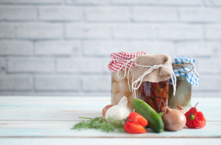 Probiotic fermented foods including gherkins, peppers and onions Stock Photo