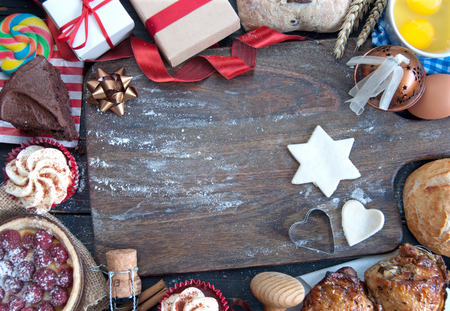 Christmas ingredients around an empty chopping board Stock Photo