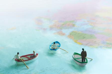 Miniature sale boats on a world map