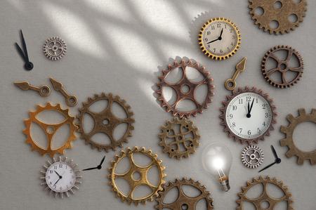 Light bulb inbetween dismantled clock parts including gears and clock hands Standard-Bild - 121547763