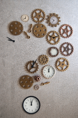 Clock parts including hands gears and cogs made in the shape of a question mark Standard-Bild - 121597190