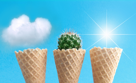 Ice cream cones on a beachy island with clouds, cactus and sun Standard-Bild - 124679918