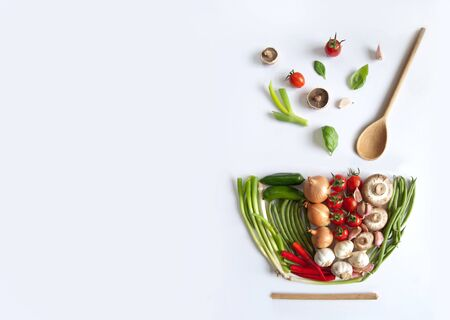 Vegetables in the shape of a soup bowl with wooden spoon Standard-Bild - 124679993
