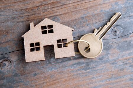 Key attached to a miniature wooden house