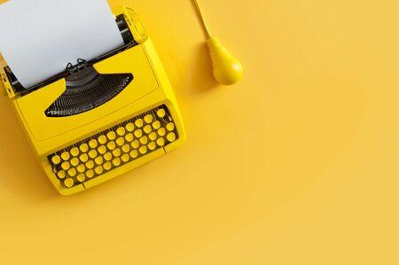 Retro typewriter with yellow light bulb, new idea, creativity