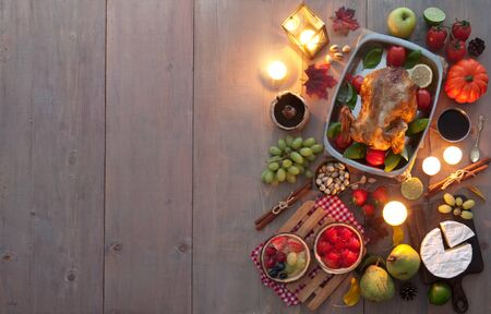 Traditional candlelit thanksgiving meal laid out on a table 写真素材